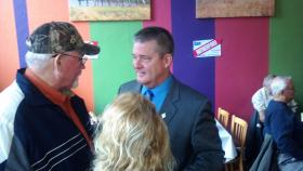 Republican Gubernatorial Candidate Dan Rutherford talks with supporters at CJ's Cafe in Pekin Friday, November 1, 2013.