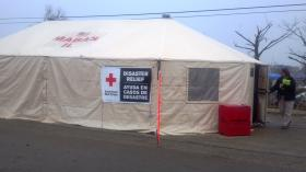 Disaster recovery tent in Washington in the Tractor Supply parking lot. The location of the press briefing Monday, December 2, 2013.