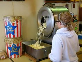 A Del's employee starts the vintage popper running to prepare for holiday snack-seekers.
