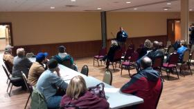Residents learn about recovery efforts at a public meeting in Pekin on Tuesday, December 17th.
