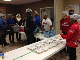 Bradley University students help pack nutritional meals at the Midwest Food Bank in Peoria.