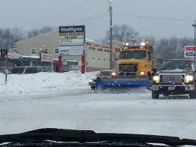 Snow crews plowing Peoria roads.