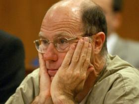 Former Symbionese Liberation Army member James Kilgore sits during his arraignment on murder charges in Sacramento Superior Court, Tuesday, May 13, 2003, in Sacramento, Calif.