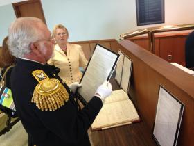 Members of the Lincoln Funeral Coalition look through the 150 year old ordinances.
