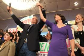 Bruce Rauner stands with wife Diana on primary election night, March 18, 2014.