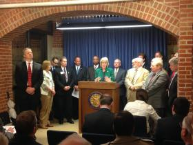 Mayors from around the state addressing media in the Capitol.