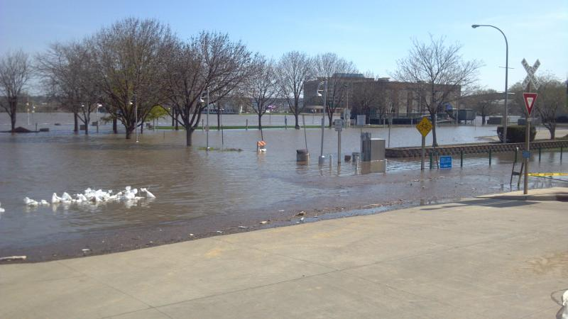 Liberty & Water Streets in Peoria looking out on the parking lot flooded by the Illinois River
