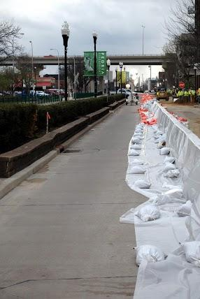 Sandbags line the sidewalk along Water Street in downtown Peoria