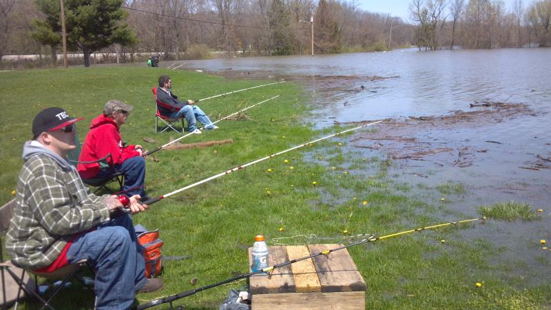 Fishermen try their luck at Detweiller Park Golf Course