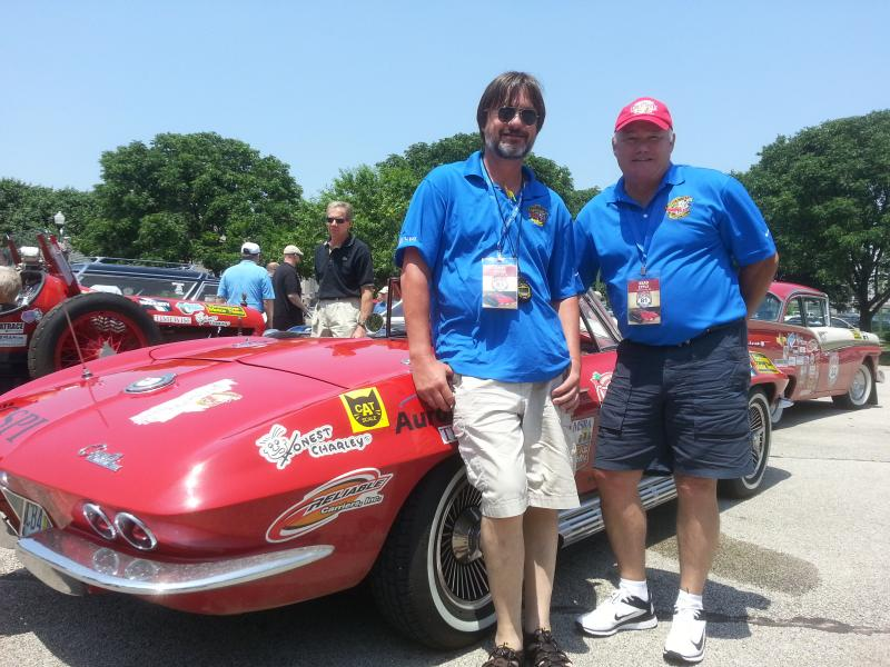 Rookies James Goode (navigator) and Brad Epple (driver), standing next to their Corvette