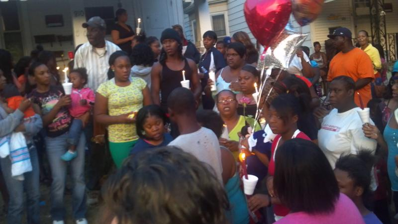 The vigil at 810 S Western Ave gathers to move to the 740 adress where Johnson's body was discovered.