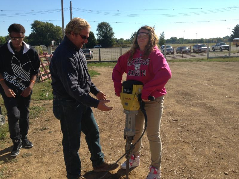 District 150 student gets to operate a jackhammer.