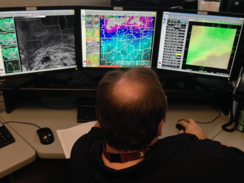 A meteorologist monitors weather conditions at the National Weather Service's office in Lincoln, Ill. on Nov. 19, 2013.