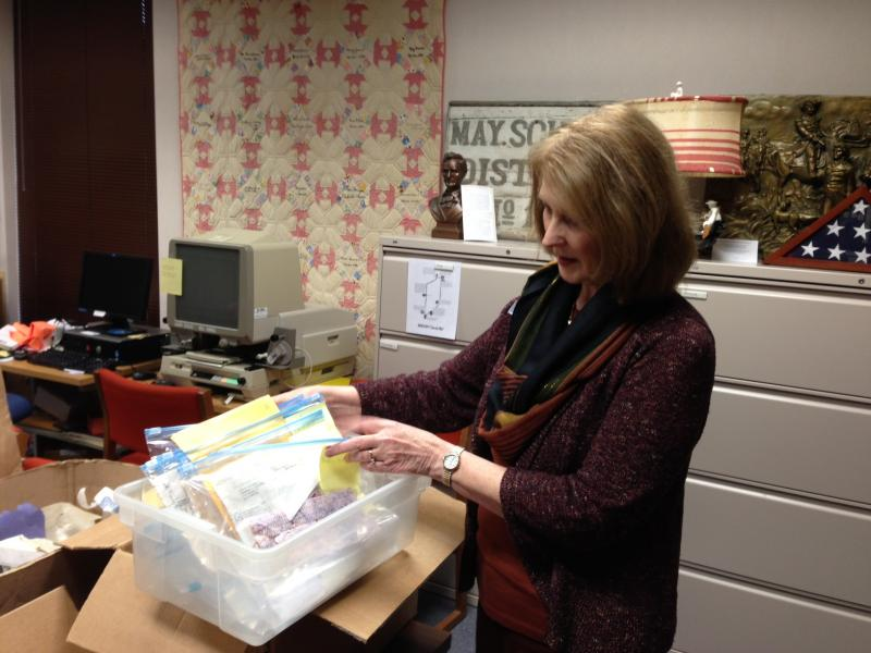 Morton Library Director Janice Sherman goes through personal paperwork found after storm
