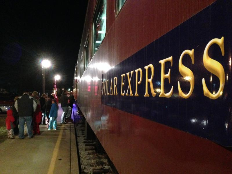 Families line up to board the Polar Express in Monticello, Ill. on Dec. 6, 2013.