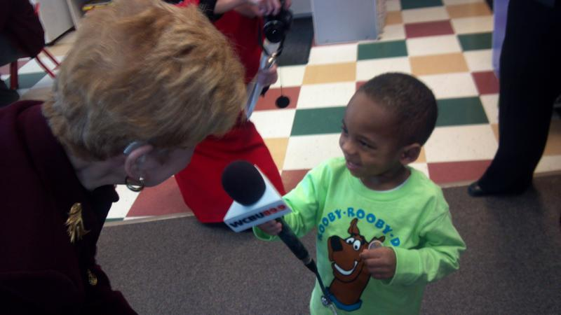 Caleb, 3 in Crittenton Centers's pre-k program handles the microphone masterfully and even did a little Q & A with Illinois State Comptroller Judy Baar Topinka. She was eager to take his questions, and even helped him craft them.