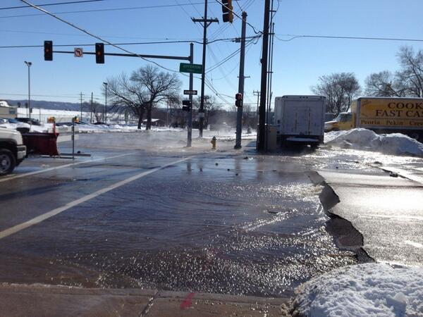 NE Jefferson at Abingdon Street buckles as water pours from transmission line.