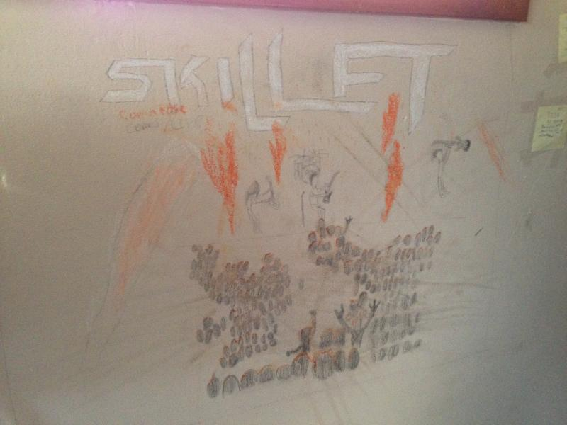 Andrew drew this picture on his bedroom wall of his favorite band, Skillet.