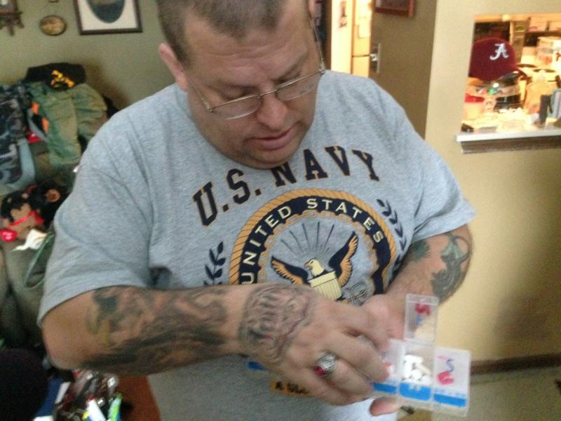 Rich Brandt shows his medication at his home in St. Joseph, Il.