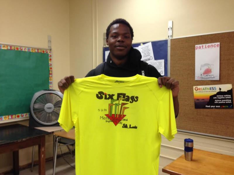 Woodruff Senior, Keith Wright, helped print the design on the most recent order for t-shirts at the school.