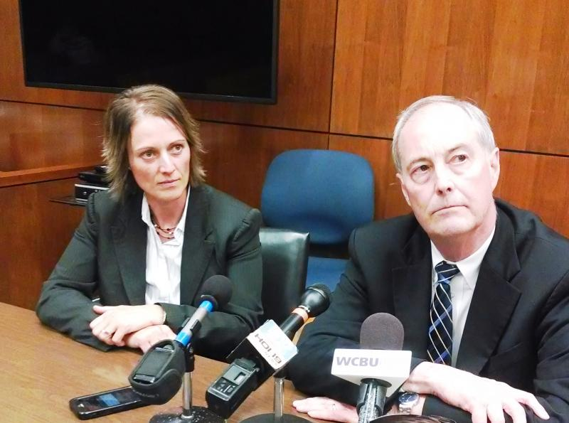 Peoria County Assistant State's Attorney Jodi Hoos and State's Attorney Jerry Brady speak with reporters at the conclusion of the Leuthold trial