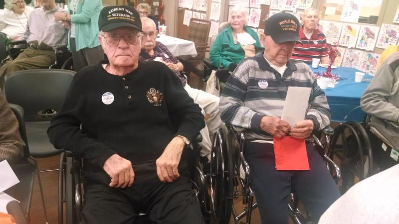 Korean War Veteran Don Dansby and World War II Veteran Charles Phelps are both Heddington Oaks residents attending the facility's ceremony Tuesday in the community room.