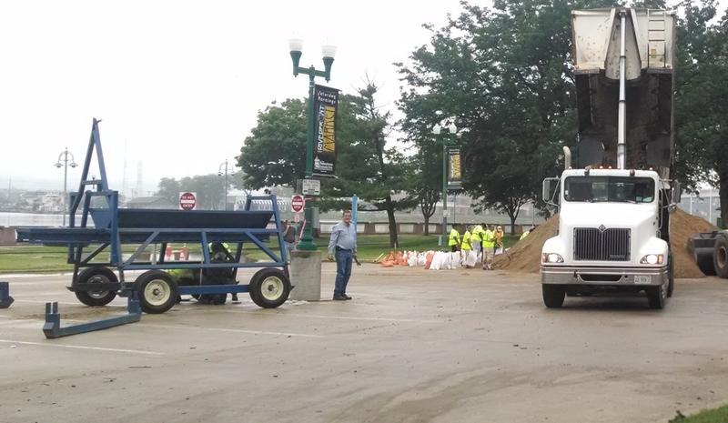 The staging area for filling the sand wall, or the Rapid Installation System going in on the Peoria Riverfront.