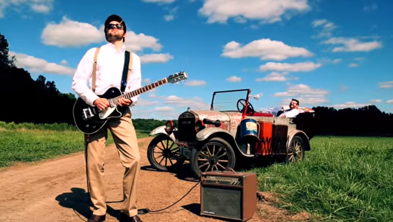 """The Next Generation: Singer Alex John Butte (in car) and guitarist Andrew Hamblin (left) tapped the Silver Streak to be featured prominently in the music video for Alex Butte's song """"Face to Face."""""""