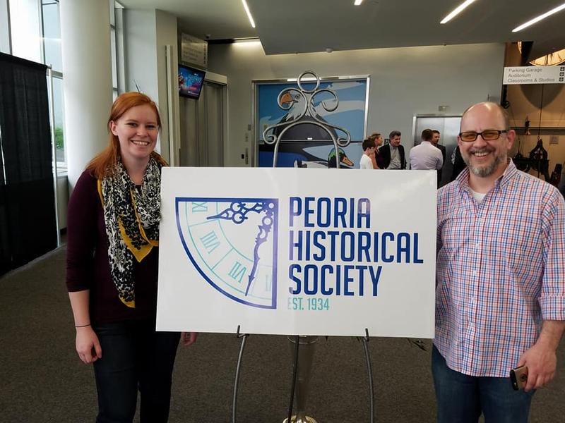 Taylor Ackerman and Kevin Kizer with Simatel, showing off the newly-designed PHS logo.