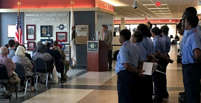 Col. Michael A. Meyer, USAF, Ret., makes comments at the dedication ceremony for the Lyman Hubbard Memorial at the Springfield Airport