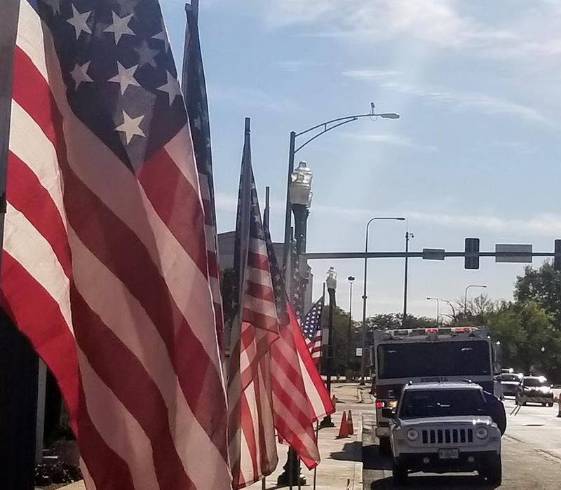 Flags line NE Perry in honor of Captain Gary Stauthammer's service.