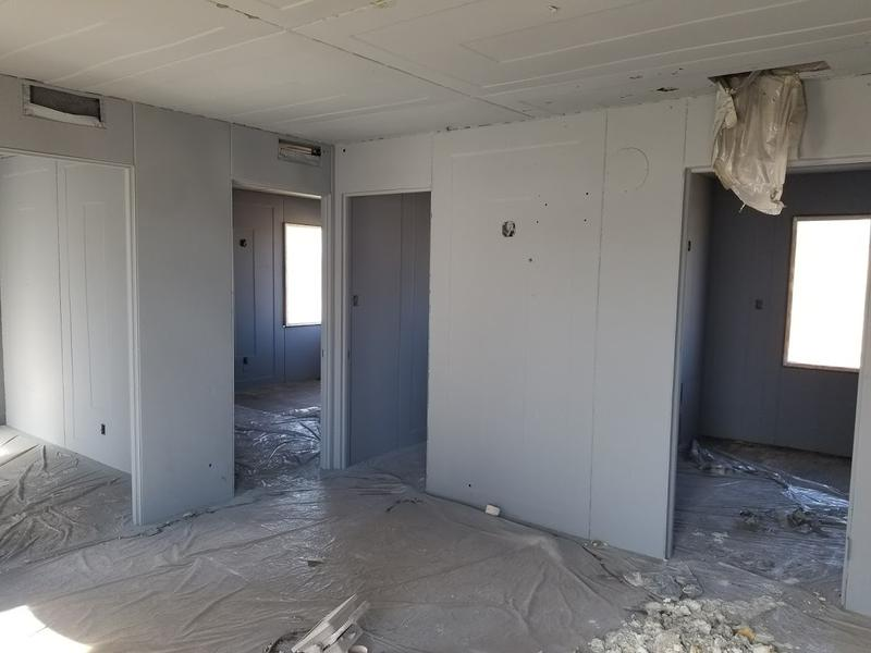 The interior of The Steel House is austere by today's standards. The doors counter clockwise are the kitchen, bathroom, master bedroom and 2nd bedroom. The house will be completed with period furnishings.