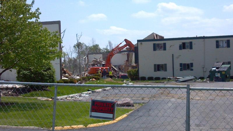 "May 20, 2014 - The caption of this picture was:  ""Crews begin demolition on the heavily-damaged Georgetown Common apartments in Washington, Illinois."""