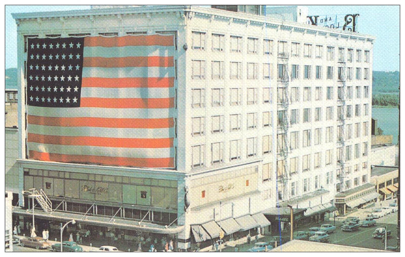 A vintage 1950s postcard depicts the downtown Block & Kuhl building in all its glory
