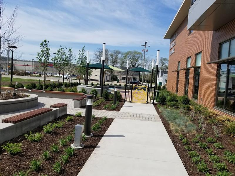 Fresh sidewalks and landscaping offer visitors an opportunity to walk from the reading garden to nearby Levee District shops and restaurants.