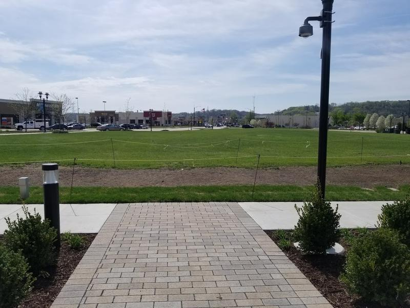 A large park will eventually fill the greenspace adjacent to the reading garden.