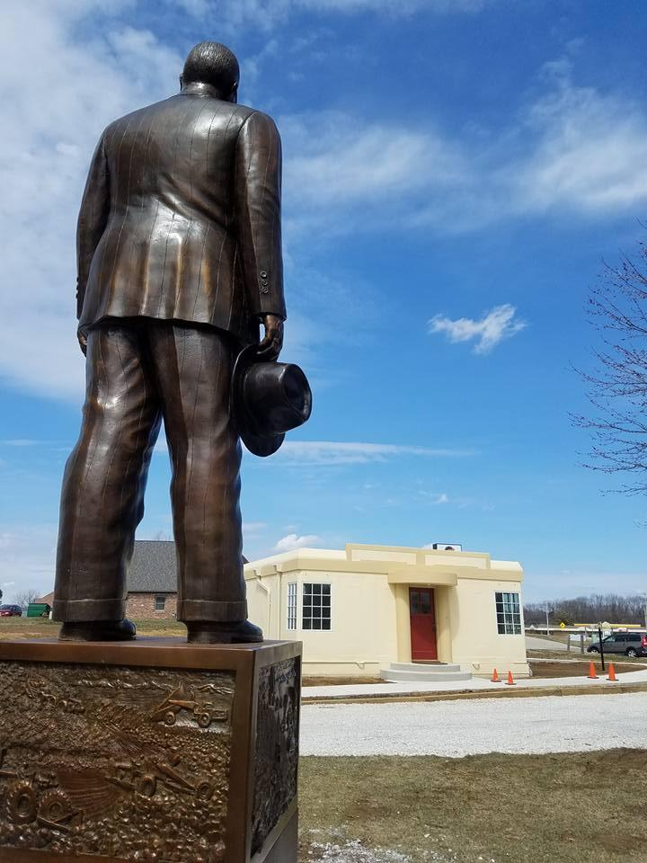A statue of industrialist R.G. LeTourneau gazes at one of his more comfortable creations. Known for building heavy equipment, the 'Carefree Steel Homes' were a departure for the Peoria manufacturer.
