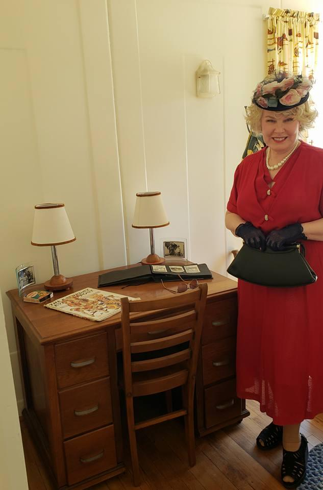 Linda Herron of the Peoria Historical Society, appeared at the LeTourneau opening dressed in 1930s attire.