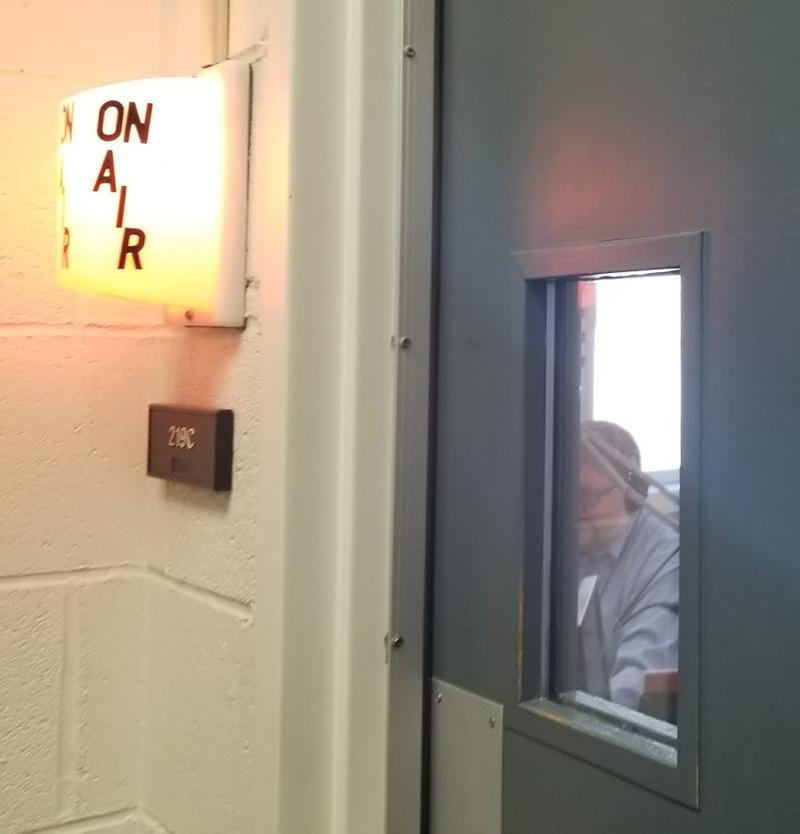 Peoria Public Radio's Operations Manager and local Morning Edition Host Daryl Scott opens the microphone for his last live-break on the air at WCBU.