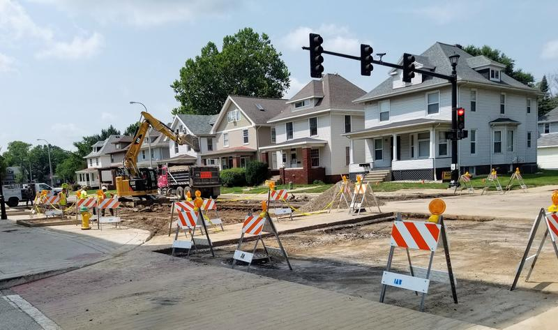 A good portion of road surface is still missing on Main Street in Peoria Friday, August 10, 2018 after the water main break Wednesday.