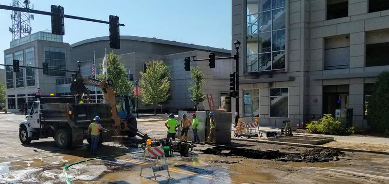 Illinois American Water workers labor to get to the main break mid morning Wednesday. Part of the road was pushed up by the pressure of the water. But additional parts of the road had to be removed to repair the broken and damaged water main.