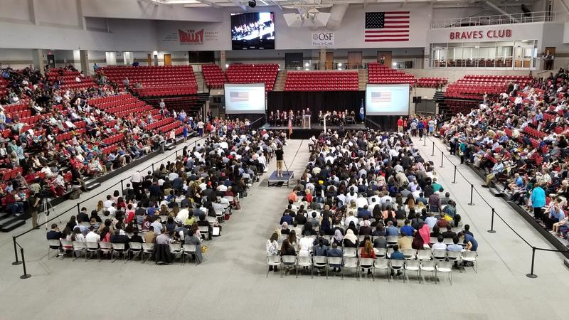 Hundreds took the American citizenship oath during a ceremony at Bradley Univeristy on September 25, 2018.