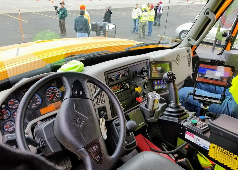 This is a view from inside the driver's seat of an IDOT snow plow. One of the screens to the right of the frame allows the driver to publish scores or grades for specific roads and their conditions.