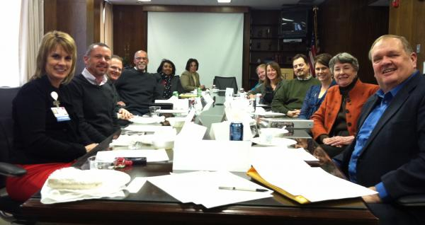 Associate Board Members at the January, 2014 meeting. Around the table from left: Shelli Dankoff, Chris Taluc, Mike Sposato, Henry Blackwell, Betty Beard (staff) Lisa Polnitz (staff), Sara Netzley, Cathy Setterlund, Nathan Irwin (staff), Sarah Zallek, Joan Ruppman, and Tom Hunt (staff). Glenn Ross was behind the camera.