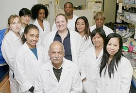 Cancer Center Director Dr. Shafiq Khan surrounded by researchers at CCRTD at CAU
