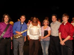 WCLK's Riva Blue with vocalist Janis Siegel and the students of Hillgrove High School