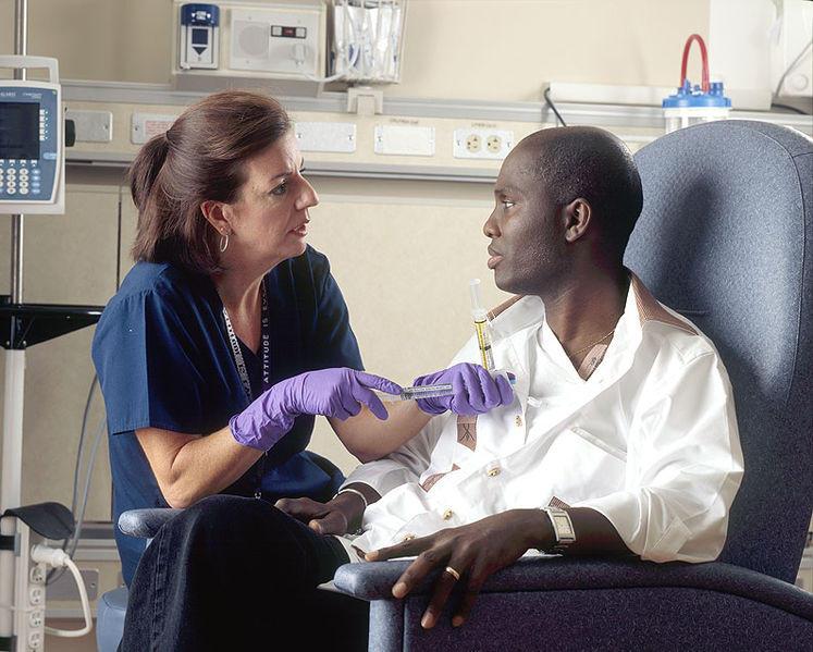 Nurse administers chemotherapy