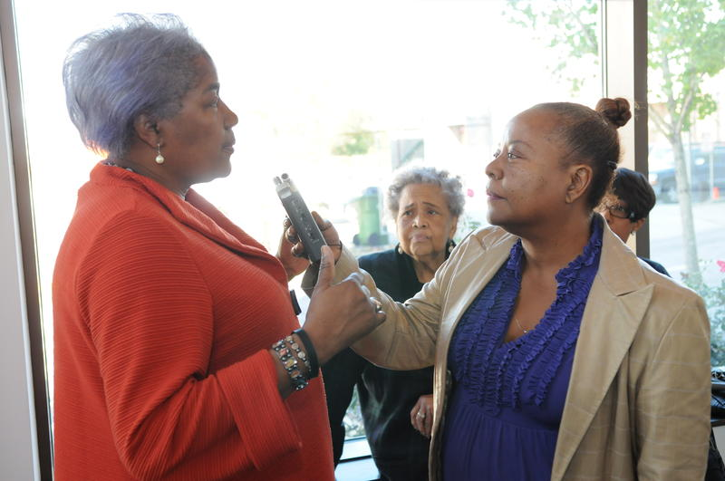 Donna Brazille speaking with Kiplyn Primus