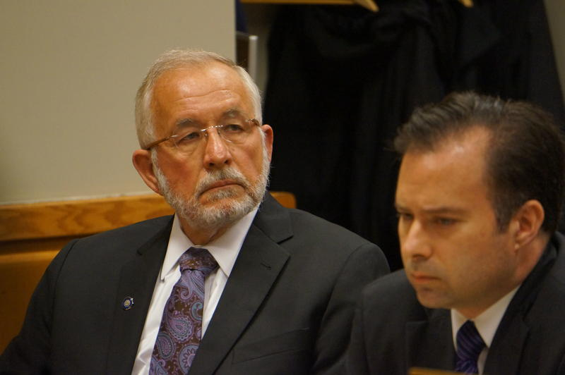 William Strampel (left) sits with his attorney during a motion hearing