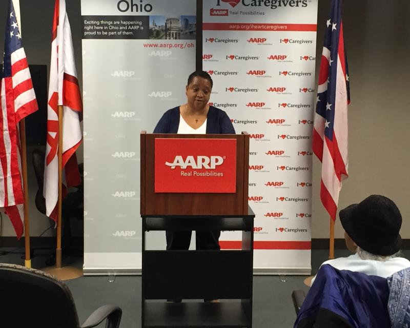Veronica Scott acknowledges her mother, Elvera, while accepting recognition from AARP